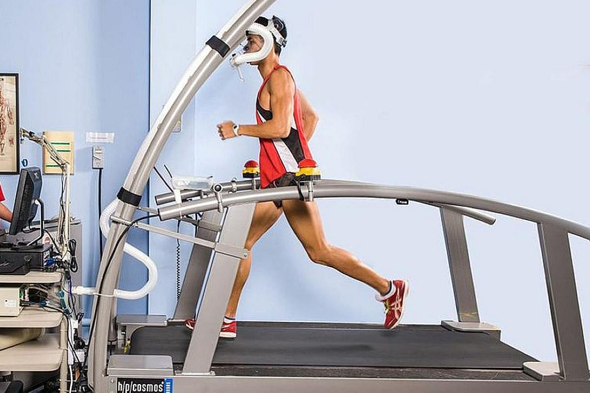 A runner undergoing a laboratory test to monitor maximum oxygen uptake (VO2max) on a treadmill at Sport Singapore.