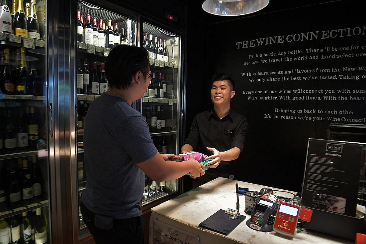 Wine Connection is among retailers which have come on board to serve as collection points. Park N Parcel user Merissa Lim collecting her parcel from the Toy Outpost outlet at Waterway Point.