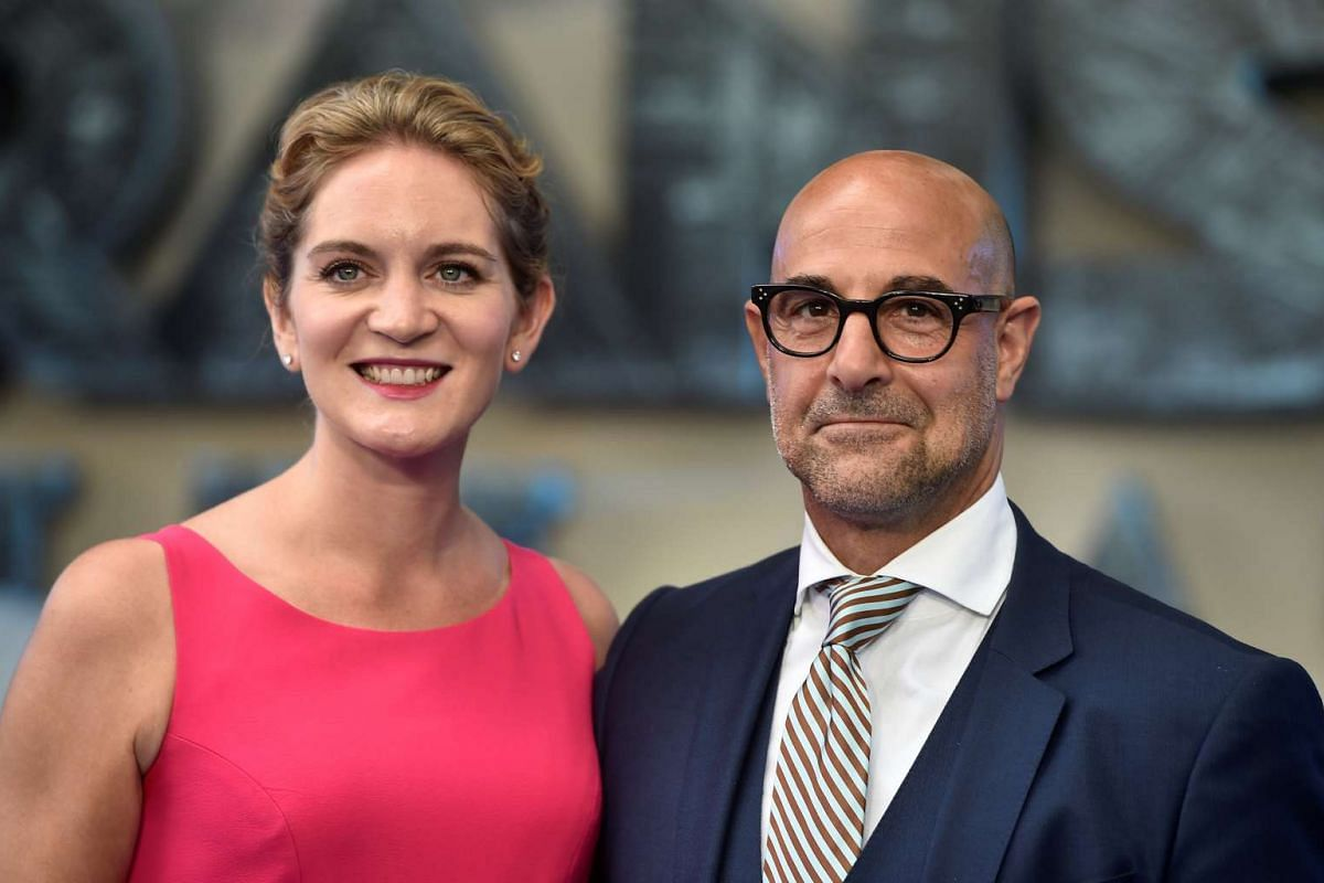 Stanley Tucci and his wife Felicity Blunt arrive for the world premiere of Transformers: The Last Knight, at a cinema in central London, Britain, June 18, 2017.