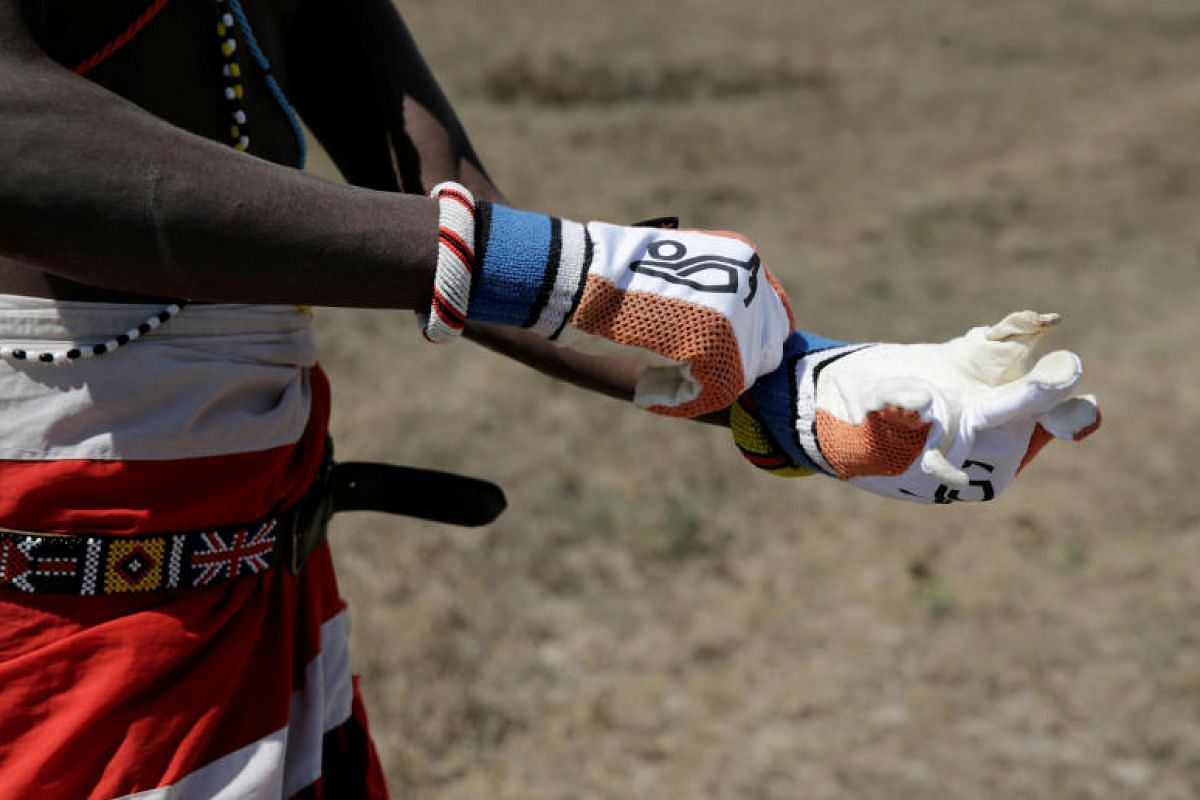Are the gloves coming off for the cricket contest? Not really. Charity comes first for this Maasai Cricket Warriors player.