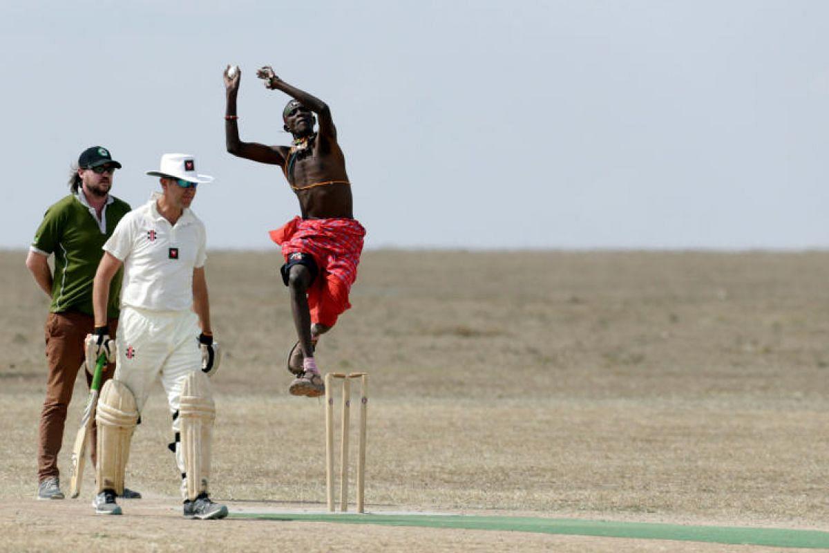 Helping the rhinos is his aim as Daniel Mamai of the Maasai Cricket Warriors bowls against the BATUK team.