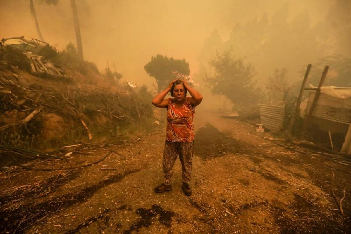 A woman reacting during a fire in Pampilhosa da Serra in central Portugal on Sunday (June 18).