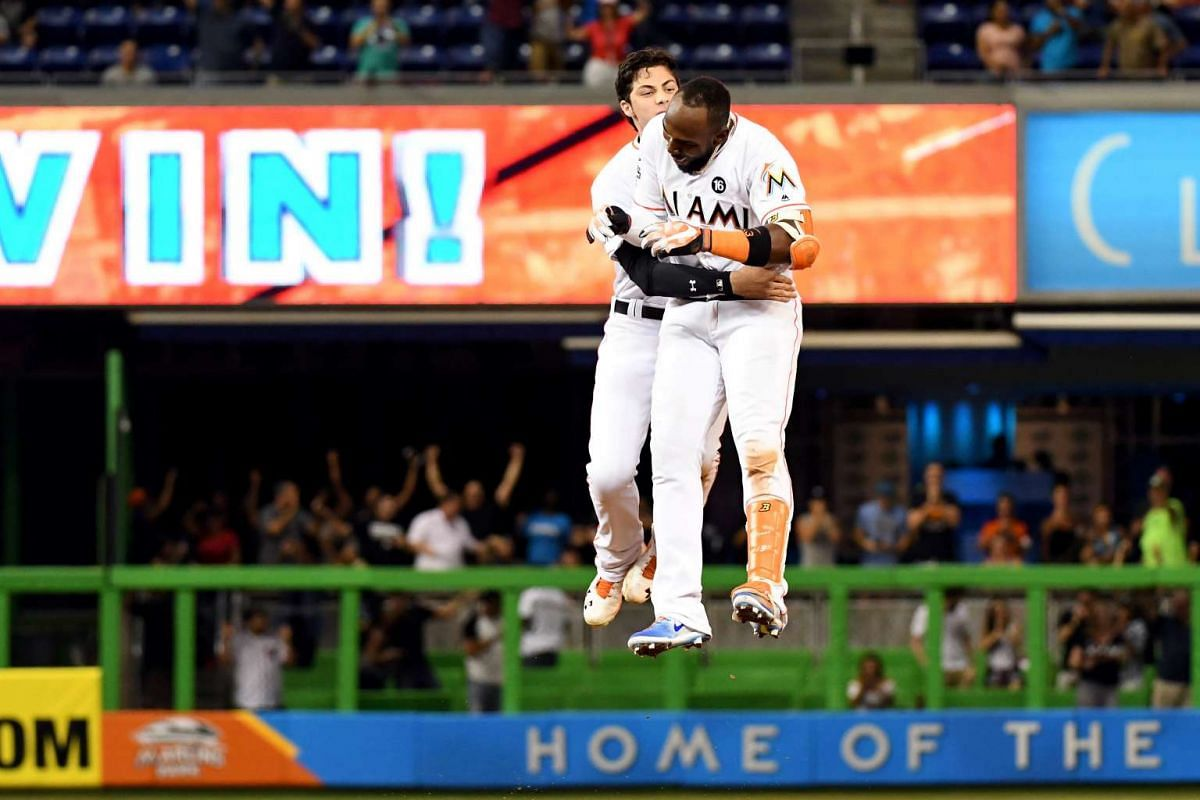 Miami Marlins center fielder Christian Yelich (L) celebrates with left fielder Marcell Ozuna (R) after hitting the game winning run in the ninth inning to defeat the Washington Nationals at Marlins Park.