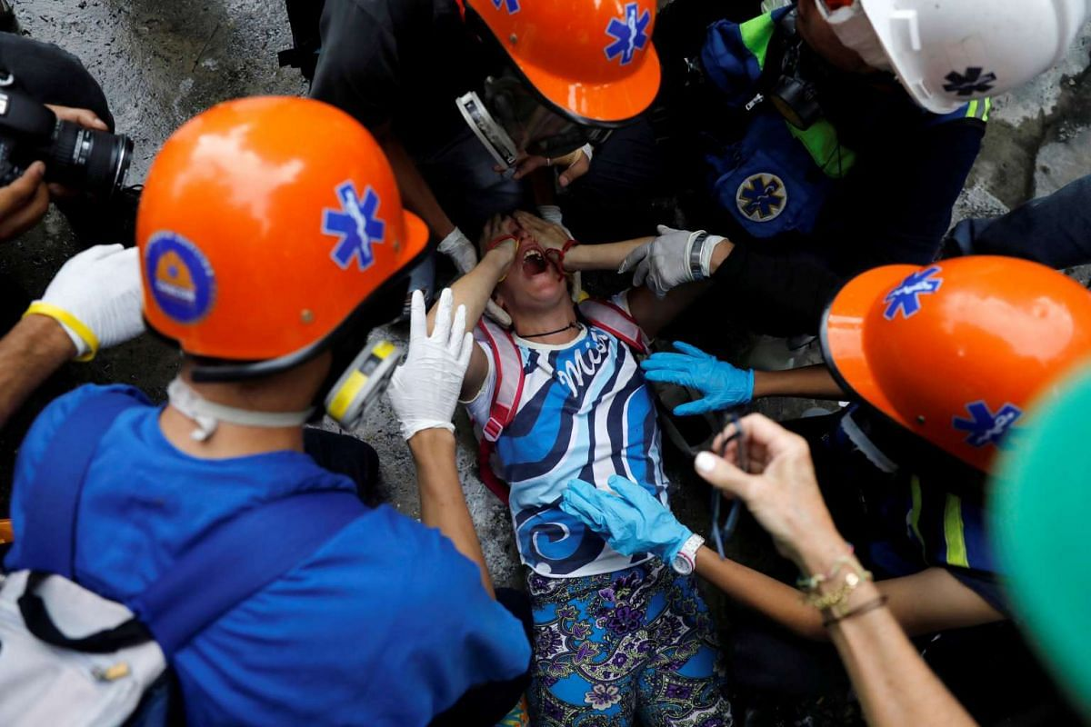 An injured demonstrator is assisted by volunteer members of a primary care response team during a rally against Venezuela's President Nicolas Maduro's government in Caracas, Venezuela, June 19, 2017.