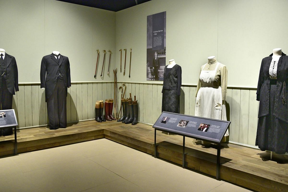 Servant uniforms are part of the more than 50 costumes on display at the exhibition of the hit British period drama.