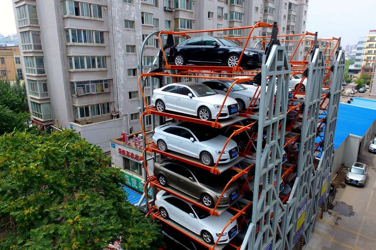 A ten-storey, three dimensional car park structure located between residential buildings in Shenyang, in China's Liaoning province. The structures can take nearly 40 vehicles and are becoming more common as more Chinese abandon public transport and d