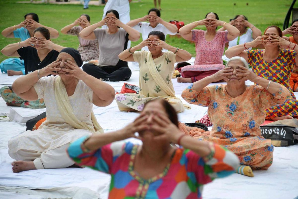 Indian yoga practitioners participate in a session at a park in Amritsar on June 20, 2017 ahead of the International Yoga Day. International Yoga Day is celebrated every year on June 21.