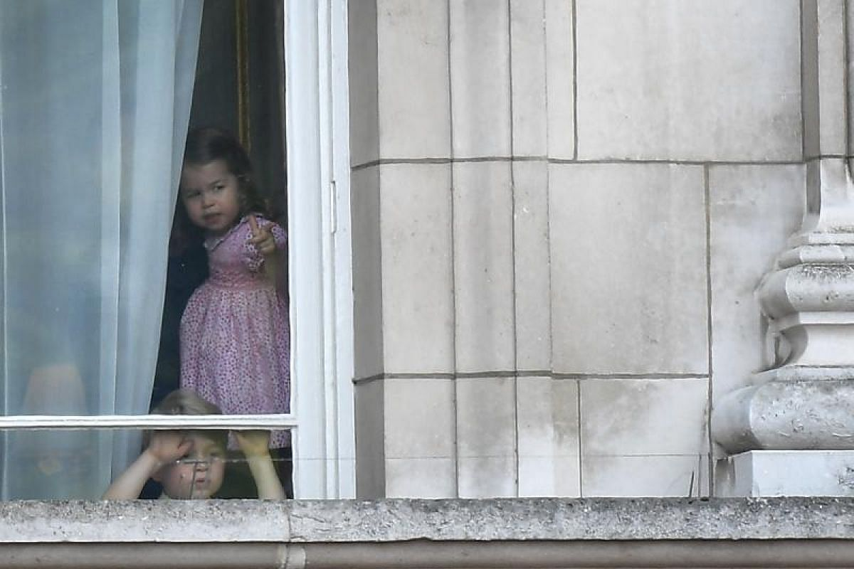 Waiting in excited anticipation inside Buckingham Palace are Prince George and his sister, Princess Charlotte, whose great-grandmother, Queen Elizabeth II, is celebrating her 91st birthday. The Trooping the Colour parade in London on Saturday (June 1