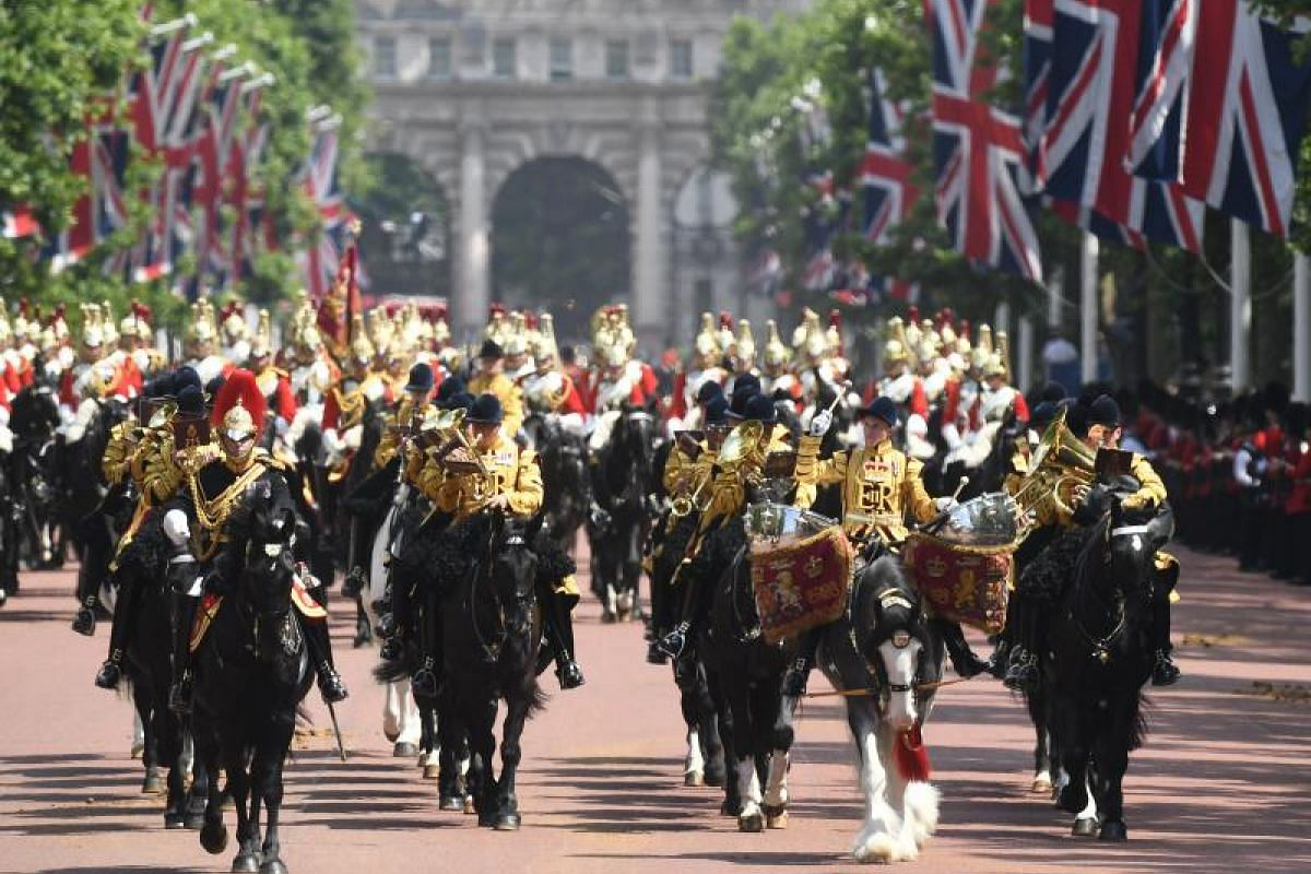 Let's hoof it home! Members of the Household Cavalry returning to Buckingham Palace after the parade.