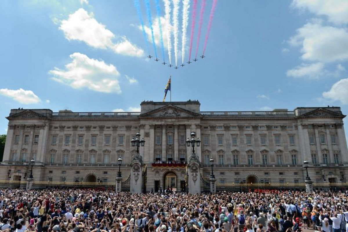 It's a day to remember for the crowds outside Buckingham Palace, as the Red Arrows soar over the royal residence.