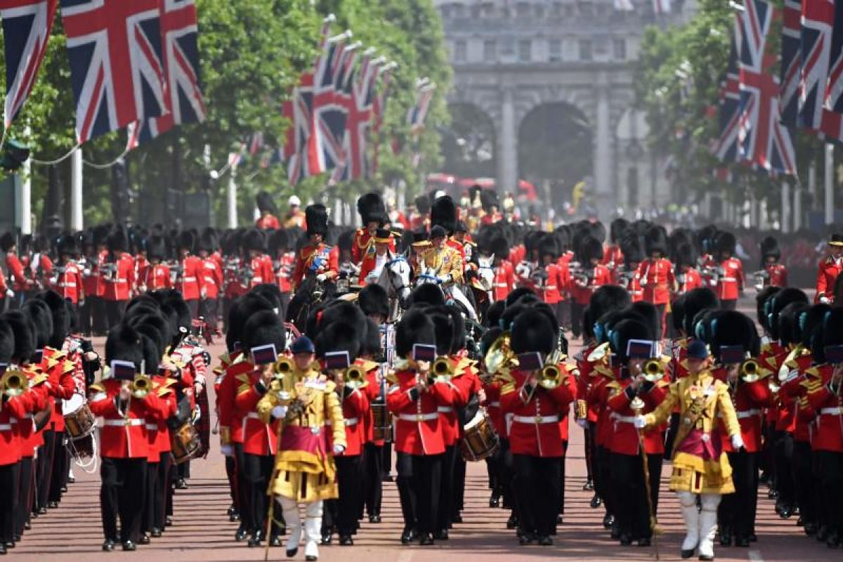 As the grand parade winds down, the Household Cavalry escorts the Royal Carriage back to Buckingham Palace.
