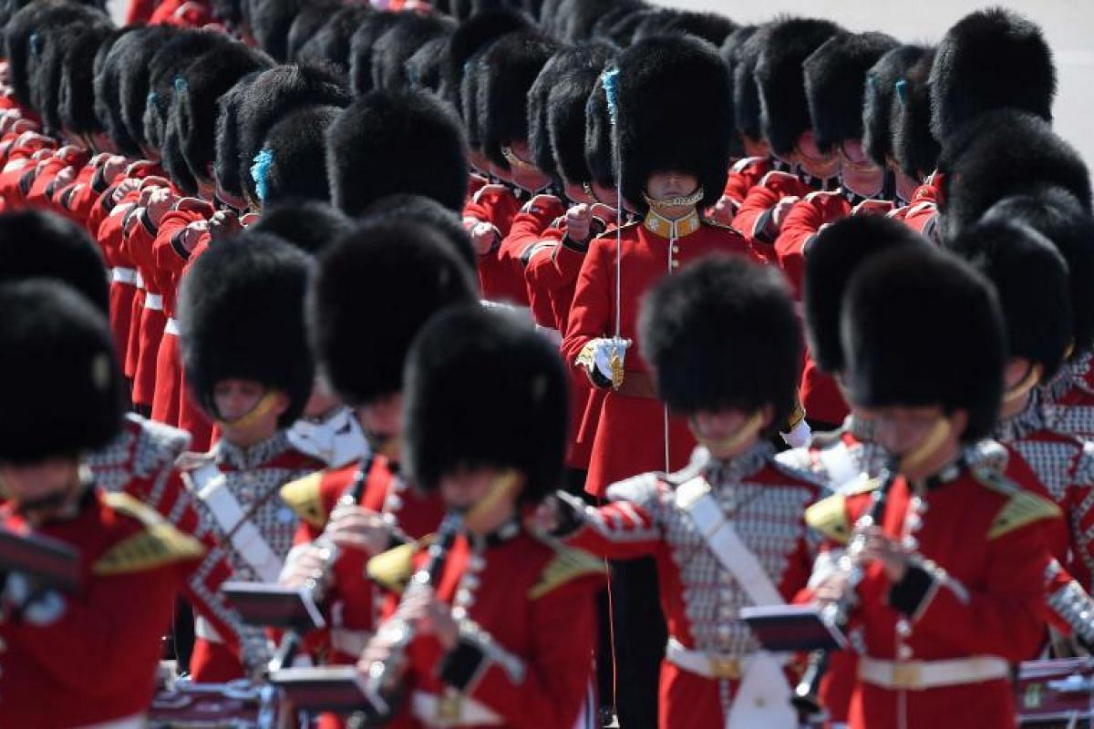 Forward march! Members of the Irish Guards, a regiment of the Household Division, putting on a well-drilled performance. The parade features more than 600 guardsmen and cavalry.