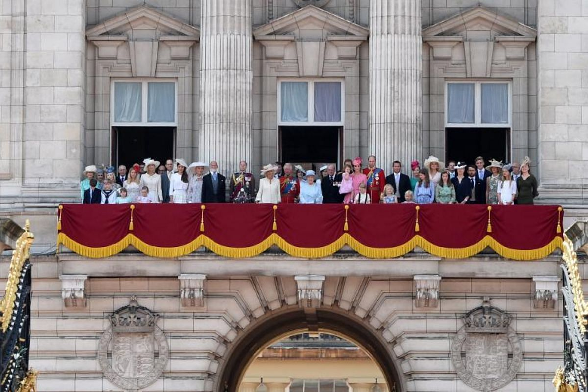 It's a regal gathering as Queen Elizabeth II and members of the royal family watch the grand ceremony from the balcony of Buckingham Palace.