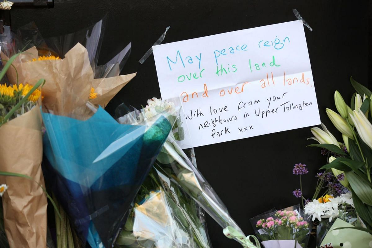 Flowers and a written message are left close to the scene of a van attack in Finsbury Park, north London.