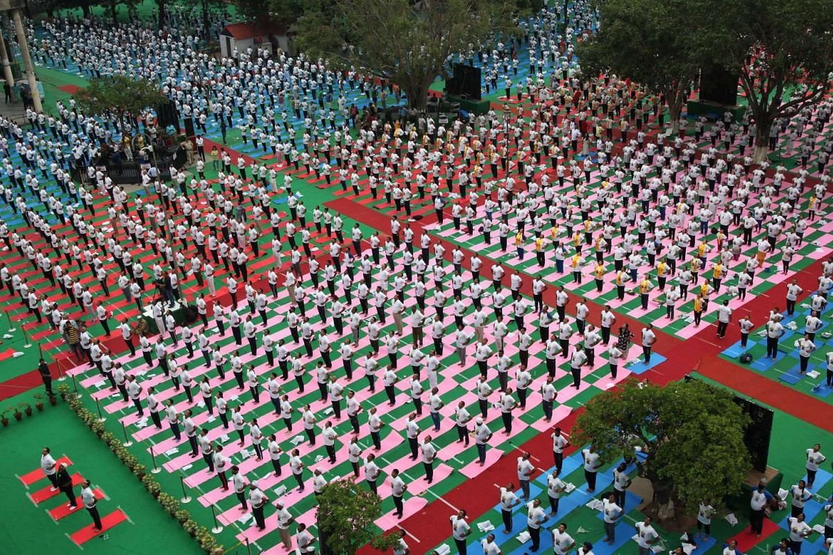 People perform yoga on International Yoga Day in Chandigarh, India, June 21, 2017