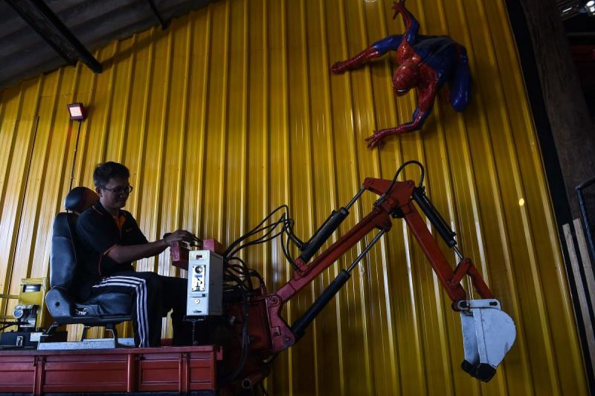 The art of his craft helps artist Phairote Thanomwong in his work as he operates mechanical toys at Ban Hun Lek.