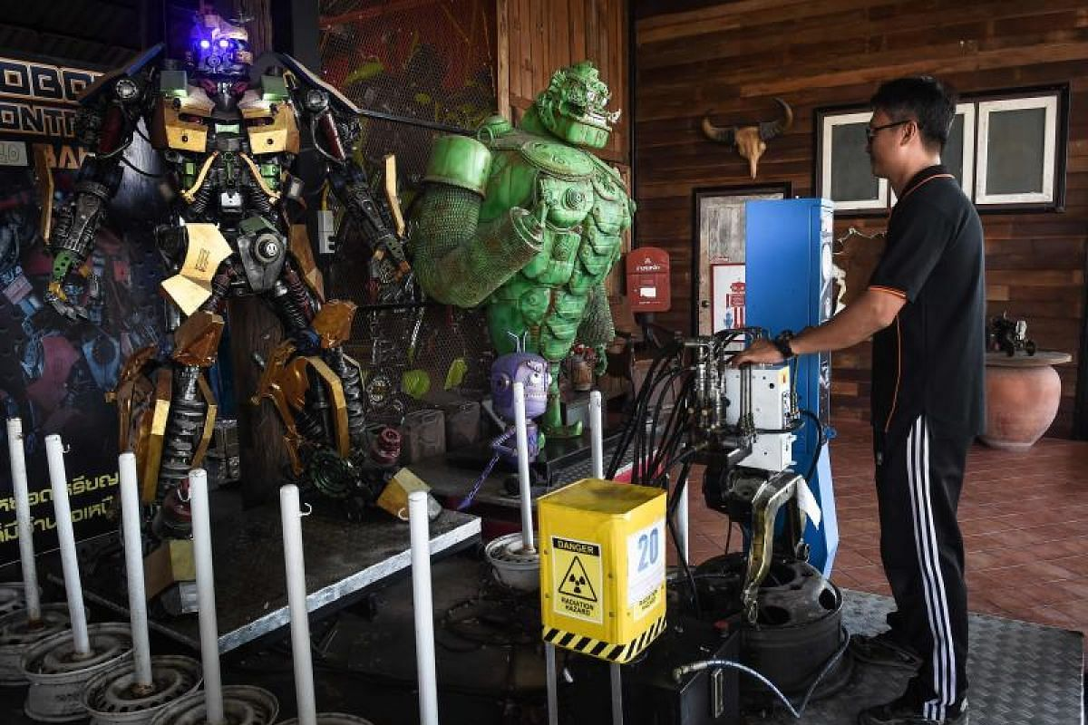 Artist Phairote Thanomwong draws inspiration from the Transformers, the Hulk and other pop icons to create the giant robots.