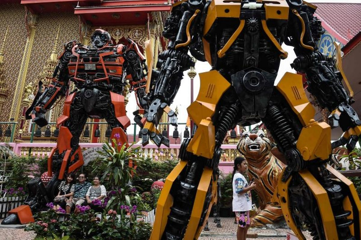 Mega-fun is in store for visitors to the Wat Tha Kien Buddhist temple in Nonthaburi as they check out giant metal statues inspired by the Transformers franchise.