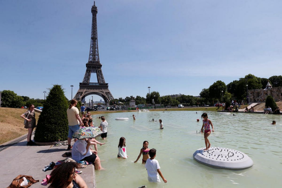 People cooling off in the waters of the Trocadero fountains, near the Eiffel tower. In Paris on Tuesday (June 20), the temperature was forecast to reach high as 36 deg C.