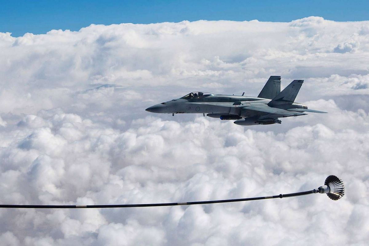A supplied image of a Royal Australian Air Force F/A-18A Hornet refueling from a KC-30A Multi Role Tanker Transport in the skies over the Middle East region April 22, 2016.
