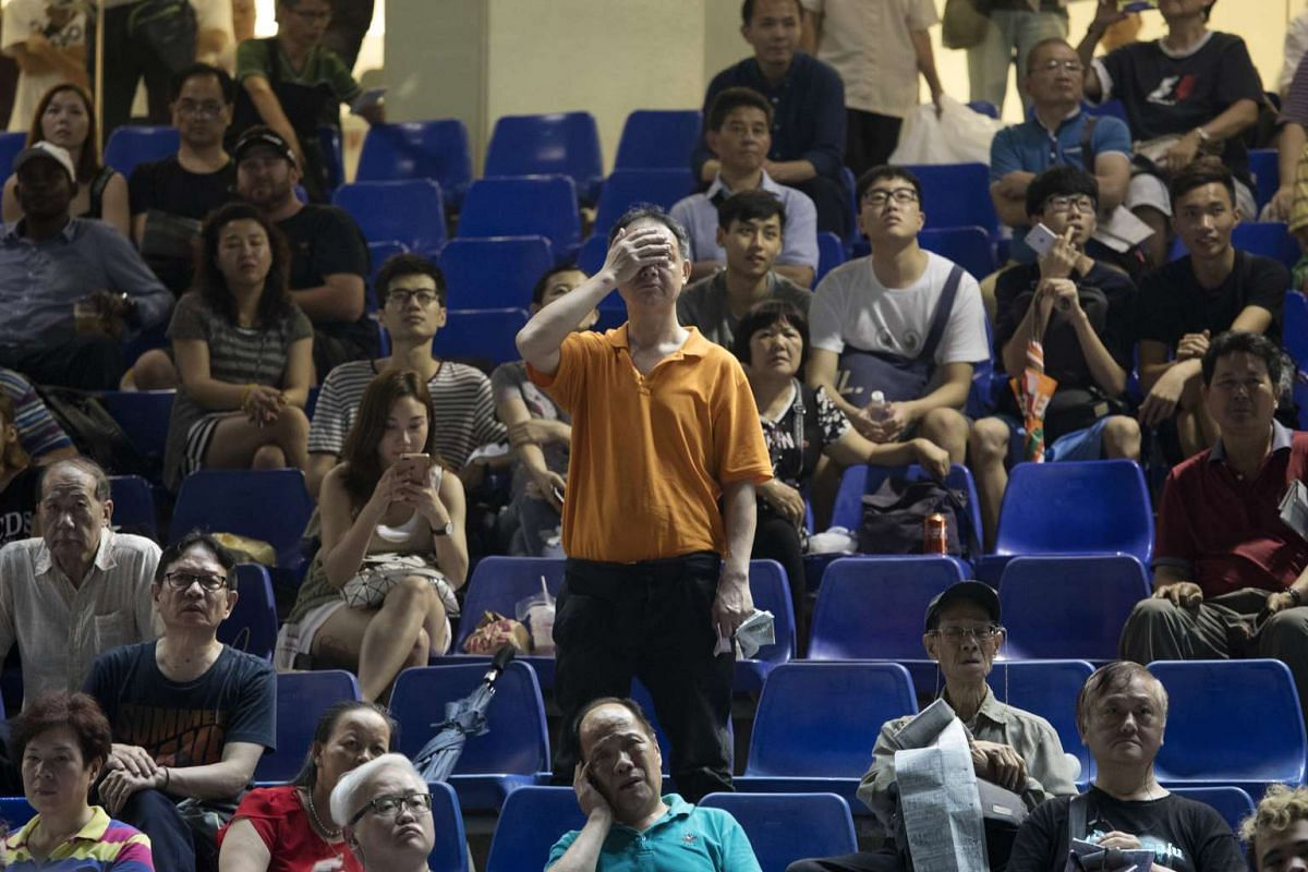 """A man reacts during a race at the Hong Kong Jockey Club's Happy Valley racecourse in Hong Kong, China, on Wednesday, June 14, 2017. One of the city's most-venerable institutions, the Hong Kong Jockey Club, which has been called an """"ATM for the govern"""