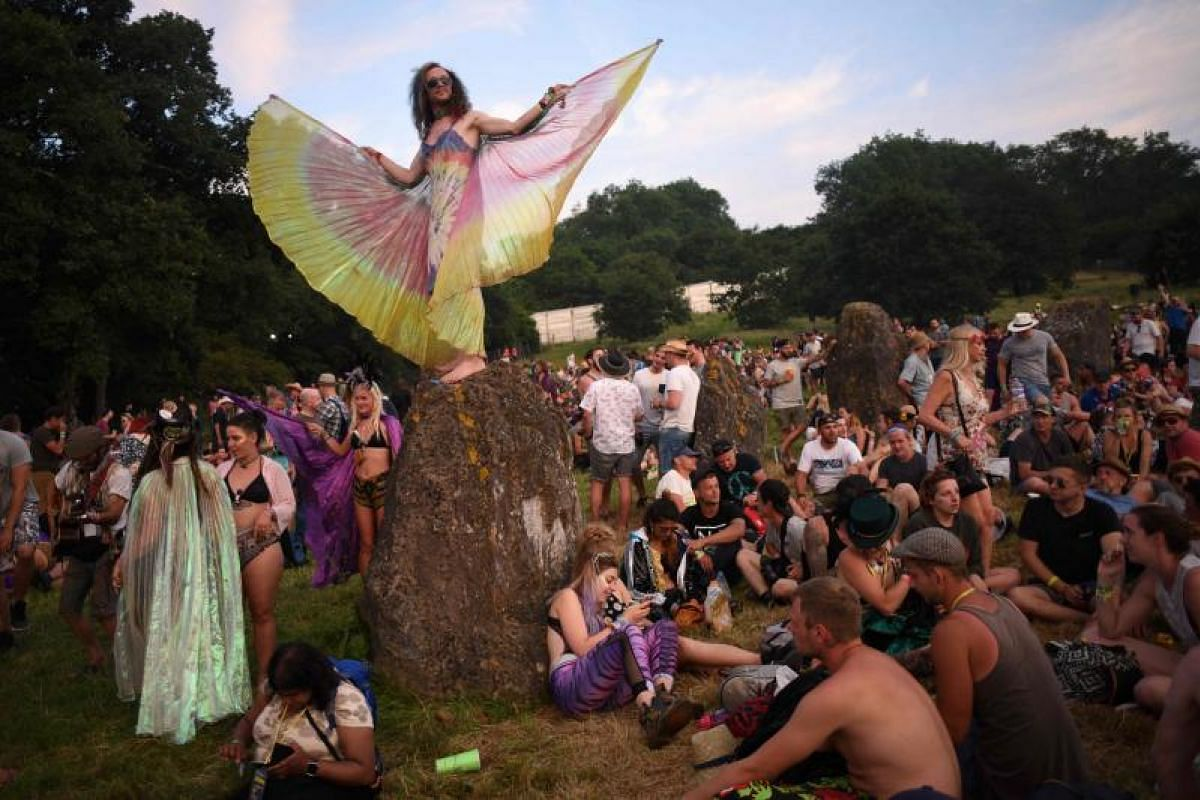 Sounds of music float all over the scene as festival-goers gather in the Stone Circle at the Glastonbury Festival of Music and Performing Arts on Wednesday (June 21).