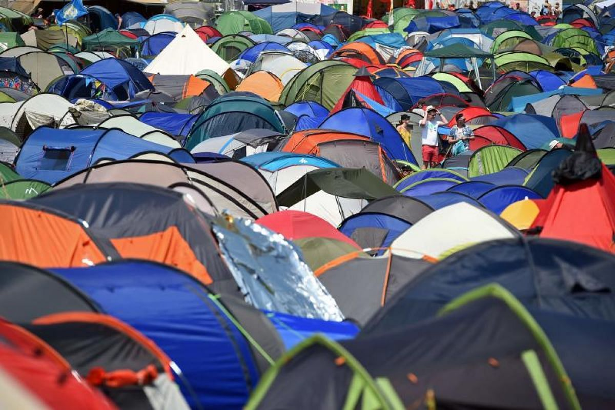 Colourful tents provide shade for festival-goers seeking shelter from the sun - even as the revellers seek shelter from the furious pace of daily life.