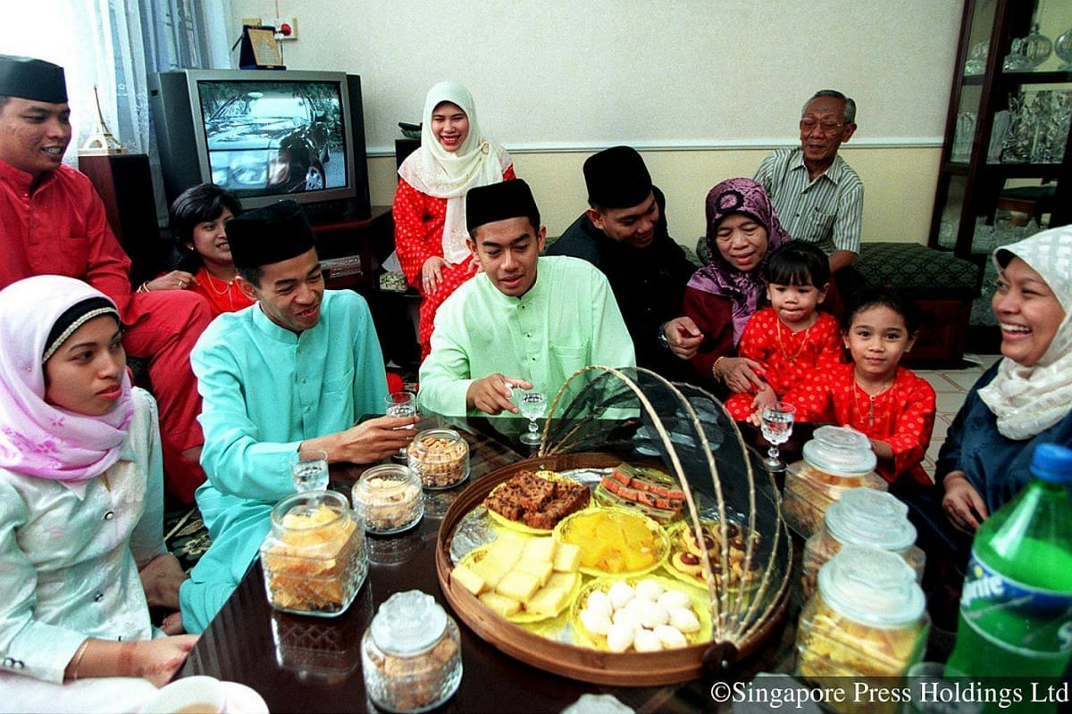2000: Large gatherings are commonplace during Hari Raya Puasa, where family members catch up while indulging in various delicacies.