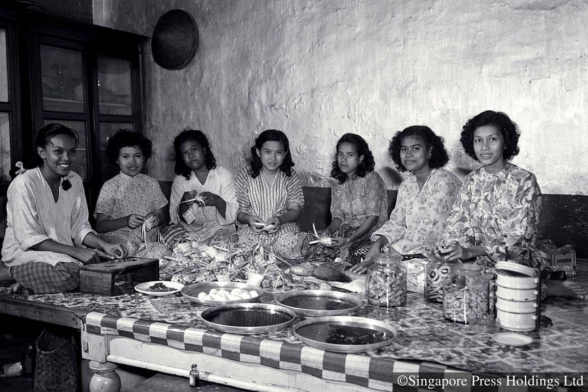 1952: Relatives and friends work together to prepare food items such as ketupat, cookies and pineapple tarts for Hari Raya Puasa. It is more common nowadays for households to purchase these items instead of preparing them.