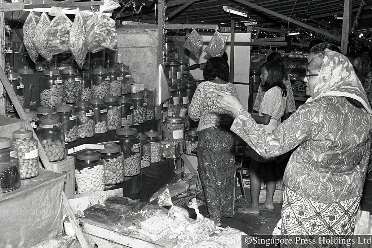 1972: Ladies buying cookies at a shop in Geylang market. For those who are busy and prefer convenience, ready made cookies are among  the first items to be purchased.