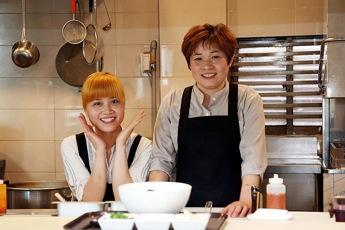 Ms Ngoc Nhon (right) and her Vietnamese compatriot Pham Thi Thoan at Asian Bowl, the restaurant they are running in South Korea after completing internships at social enterprise Oyori Asia.