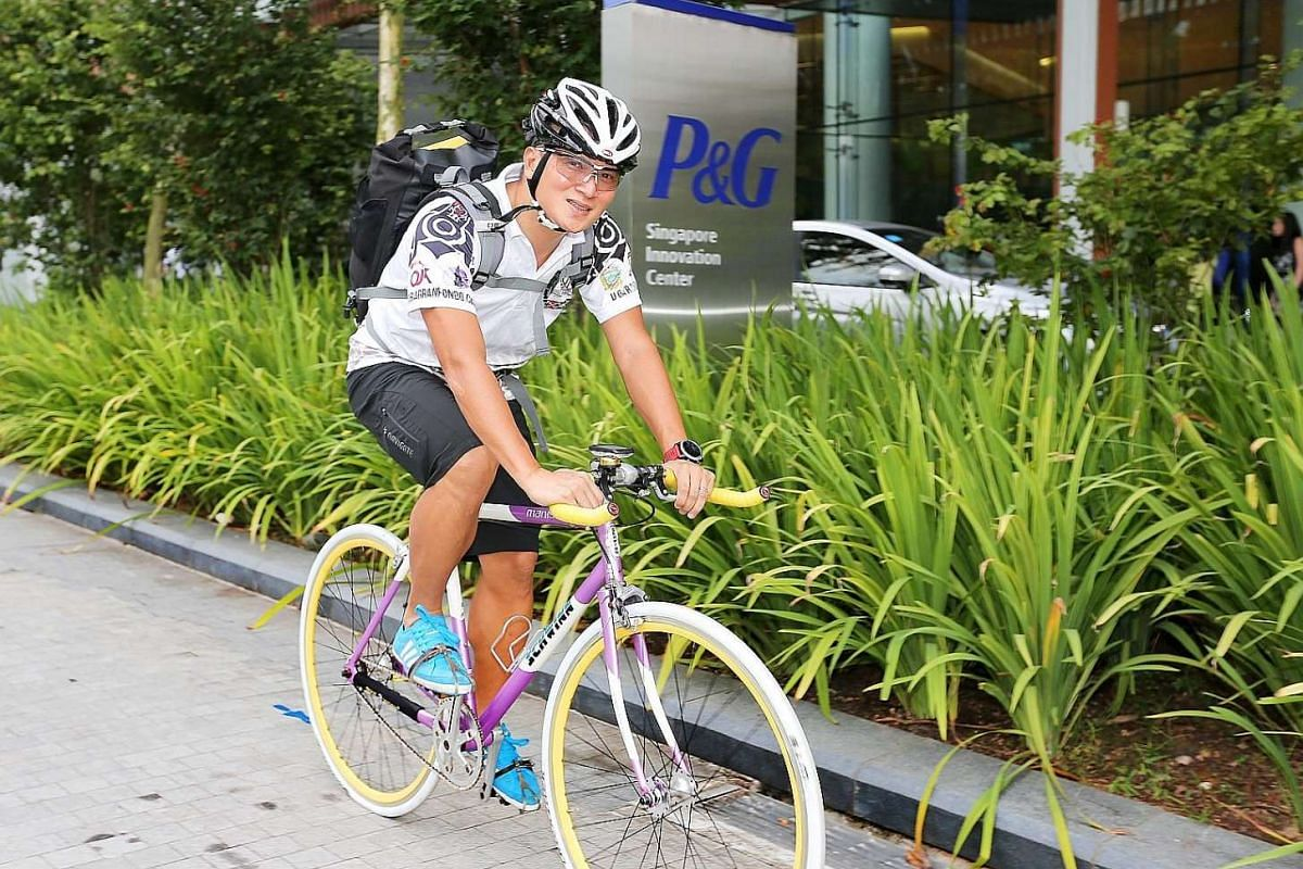Mr Norman De Villa, a Filipino, cycles from his home in Lorong Chuan to his Biopolis workplace three times a week.