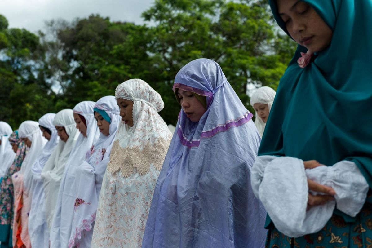 Indonesian Muslim devotees gather in Victoria Park to mark Eid al-Fitr in Hong Kong, China, on June 25, 2017.