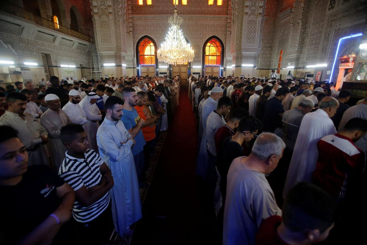 People praying at a Sunni mosque, during Eid al-Fitr as they mark the end of the fasting month of Ramadan, in Baghdad, Iraq on June 25, 2017.