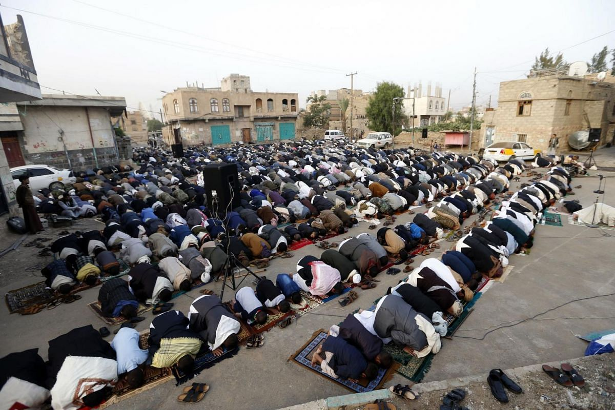 Yemeni Muslim worshippers performing Eid al-Fitr prayers at a square in the capital Sanaa, marking the end of the fasting month of Ramadan, on June 25, 2017.