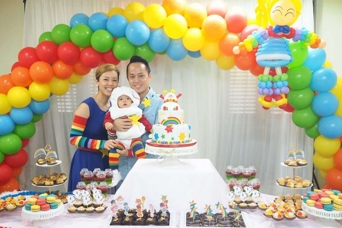 Spent $3,000: Ms Alvina Tiang and her husband Amos Lim with their daughter Aleia at her Rainbow Brite-themed party.