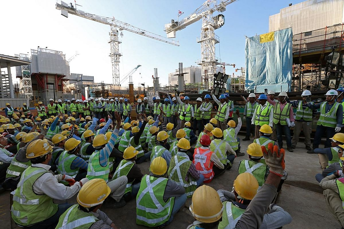 Muslim workers raising their hands to indicate they were fasting so that their supervisors could take note of who they were, and be mindful of their well-being. Lendlease supervisors in charge of men working on the new Paya Lebar Quarter conduct safe