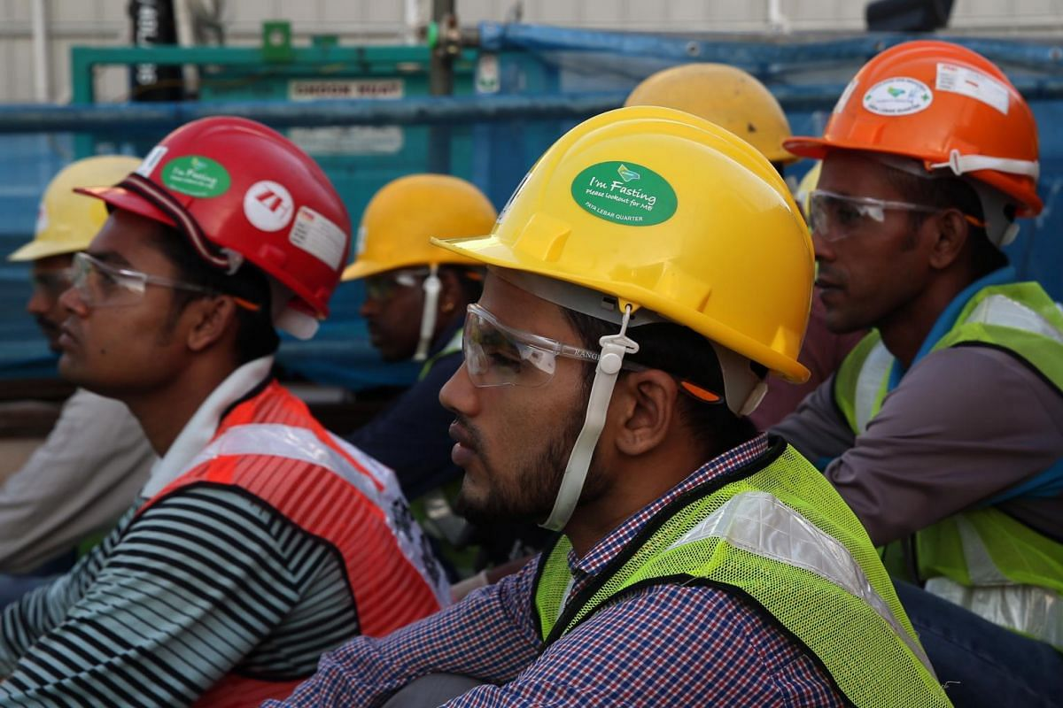 Workers who are fasting are issued with a special sticker on their hard hats.
