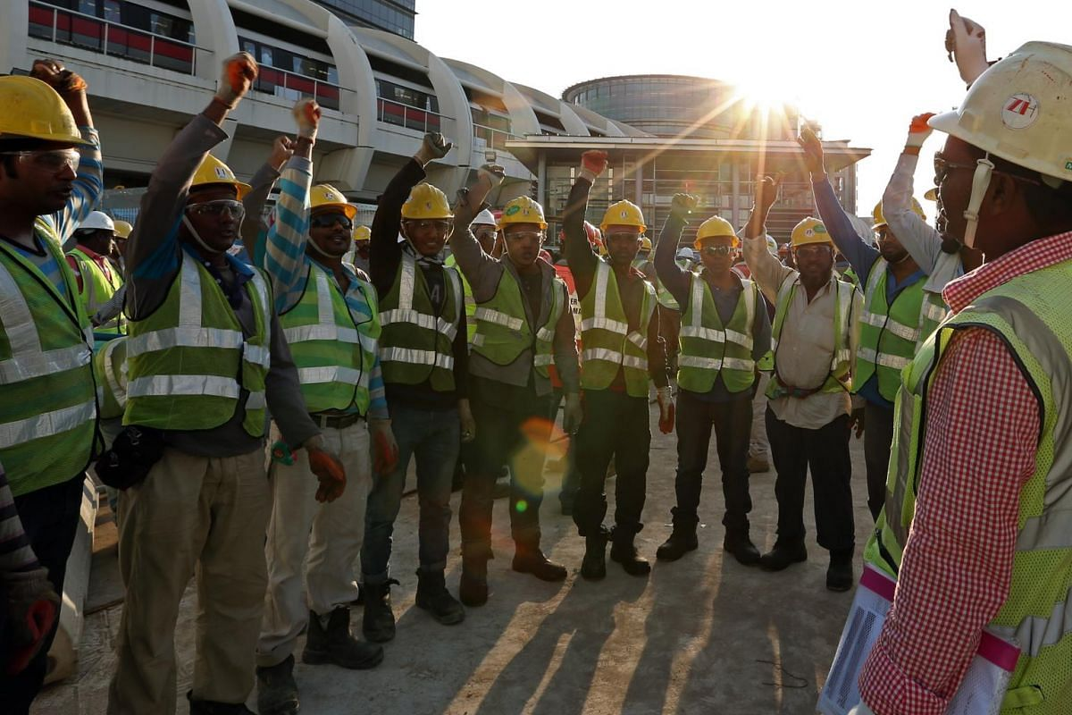 "A team of Bangladeshi workers who are all fasting does an ""incident and injury free"" safety cheer before they start their day at Paya Lebar Quarter."