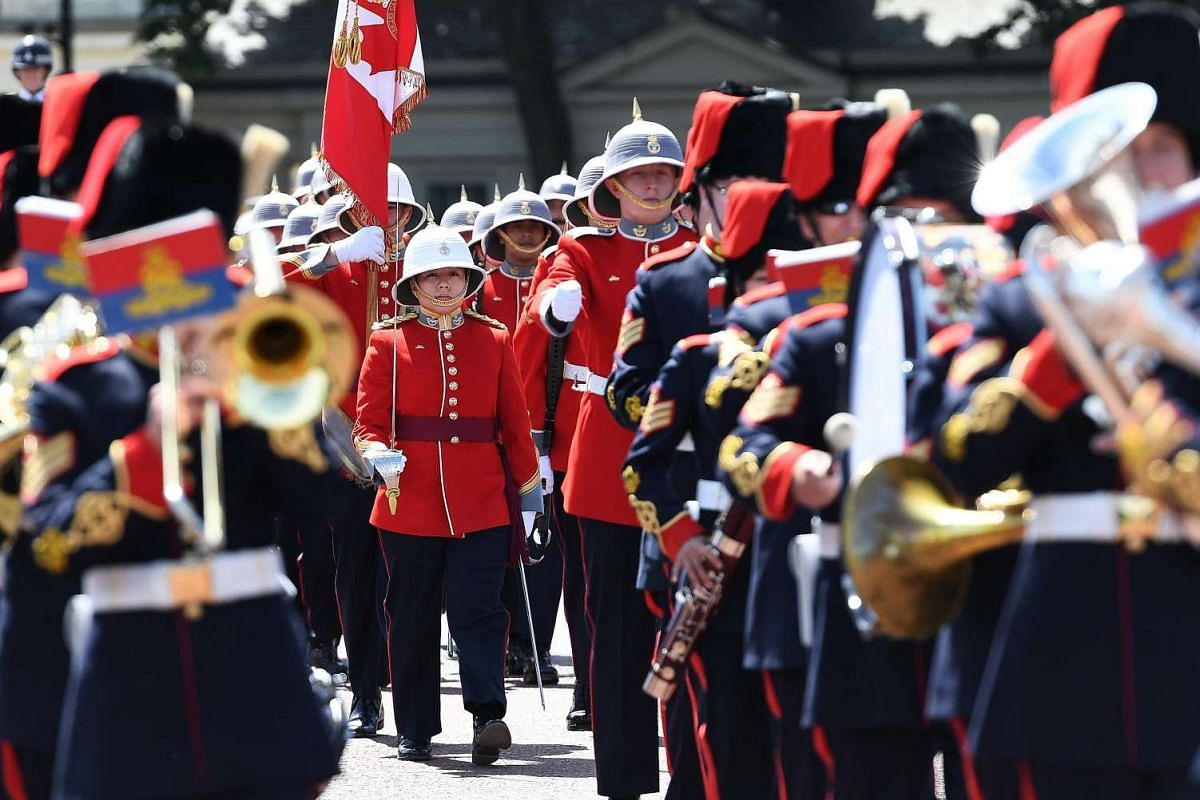Canadian Captain Megan Couto (C) leads out troops of the Second Battalion, Princess Patricia's Canadian Light Infantry from Wellington Barracks heading for the Changing of the Guard ceremony at Buckingham Palace in central London, Britain, June 26, 2