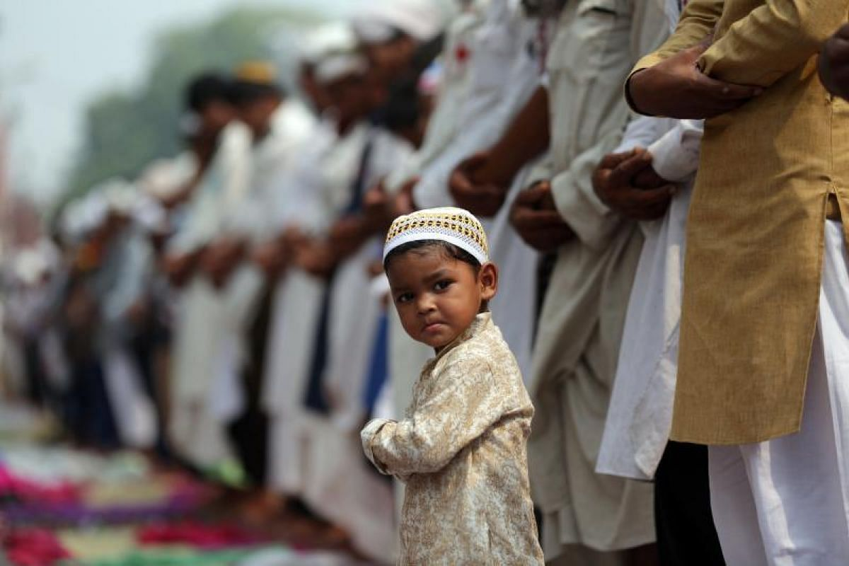 A boy doing his prayers during Eid al-Fitr at the Khairudin mosque in Amritsar, India on Monday (26 July). The Eid al-Fitr festival is celebrated by Muslims all over the world with prayers, readings from the Quran and by spending time with family and