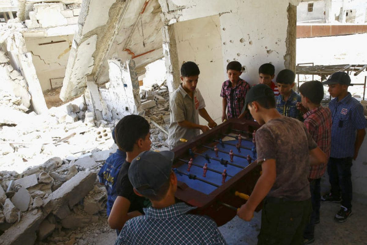 A group of boys playing table football during Eid al-Fitr in the rebel-held Douma neighbourhood in Damascus, Syria on Monday (June 26).