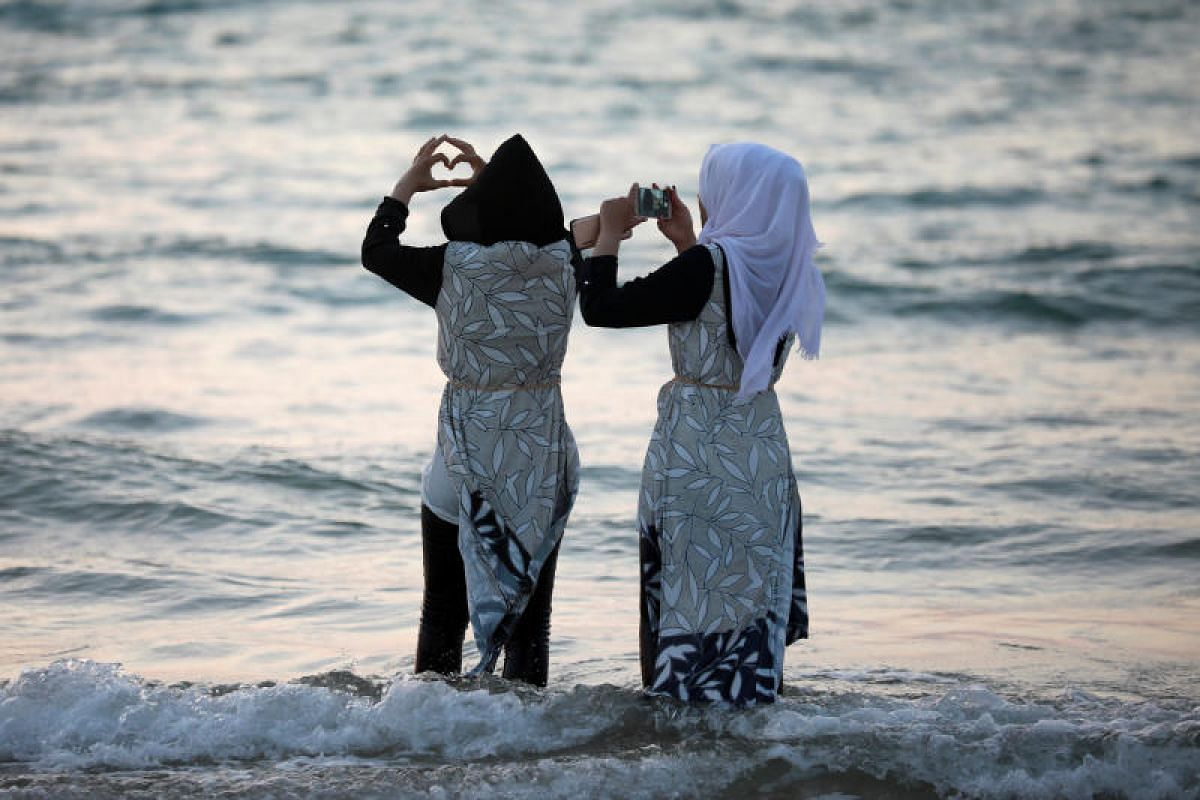 Muslim women in Ashkelon, Israel on the shores of the Mediterranean Sea during the Eid al-Fitr Muslim holiday on Monday (June 26).
