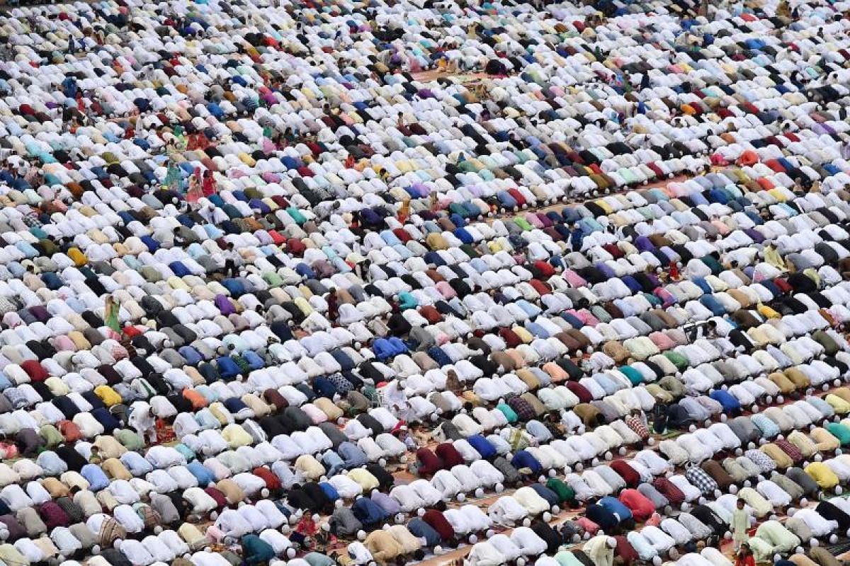 Indian Muslims taking part in Eid al-Fitr prayers in Bangalore on Monday (June 26). India is home to the world's second-largest Muslim population of about 176 million.