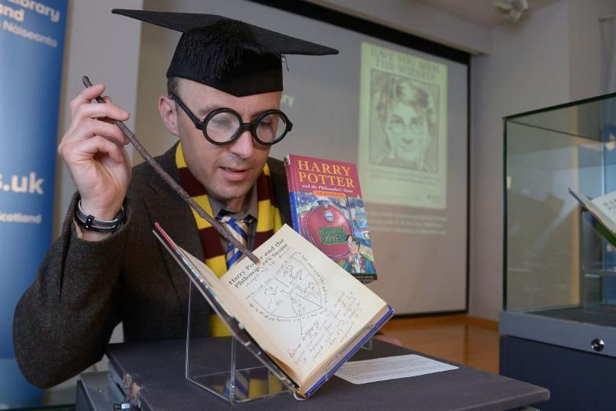 It's a magical moment for this muggle fan as he views handwritten notes by J.K. Rowling inside a rare first edition of her book Harry Potter and the Philosopher's Stone.
