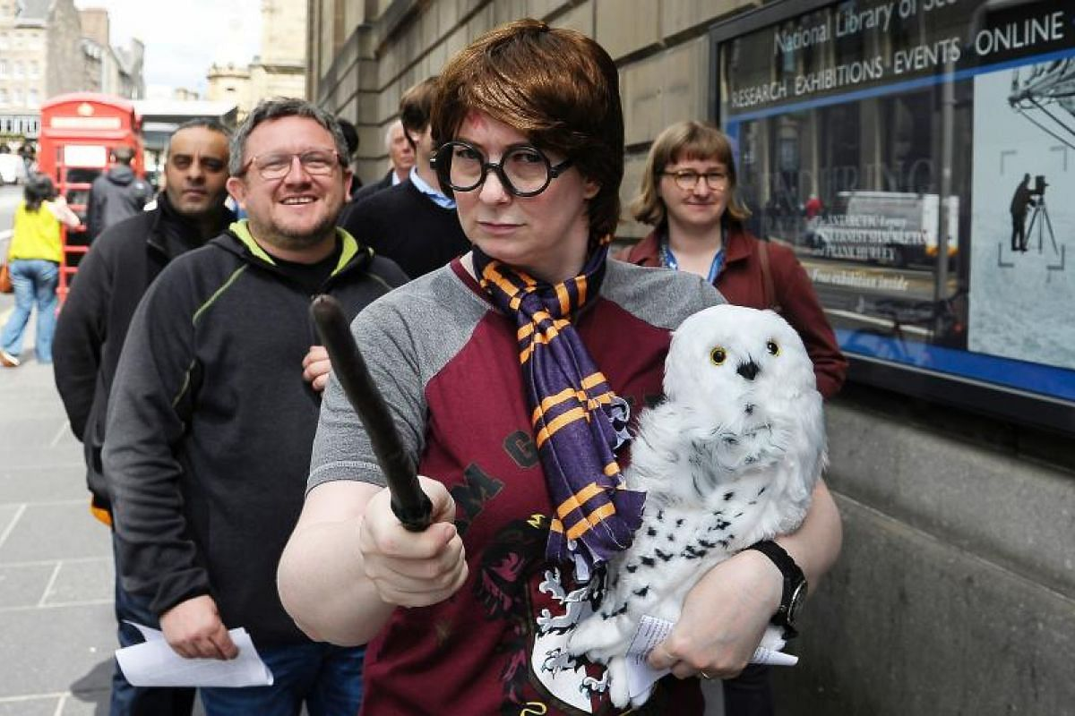 The magic spell remains for this Harry Potter wannabe as fans queue outside The National Library of Scotland in Edinburgh to view a rare first edition of Harry Potter and the Philosopher's Stone.