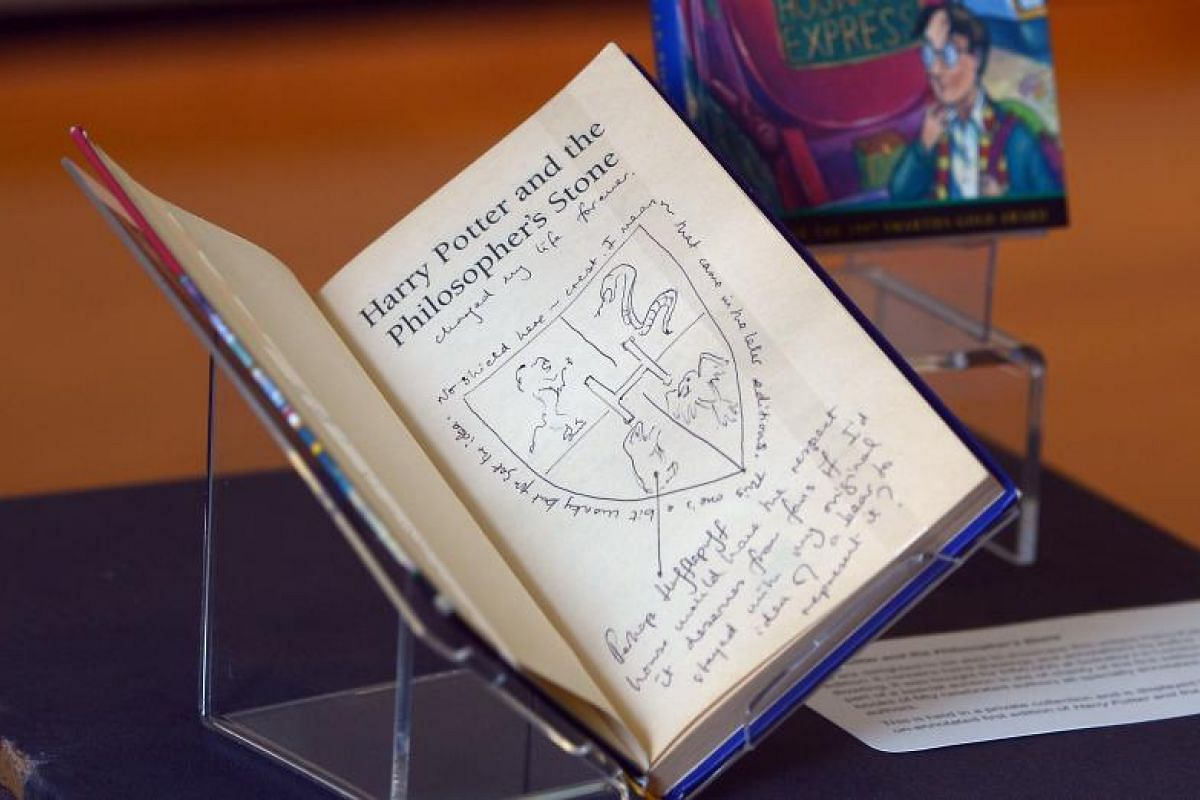 Handwritten notes by author J.K. Rowling are pictured inside a rare first edition of her book Harry Potter and the Philosopher's Stone, on display at The National Library of Scotland in Edinburgh. Harry Potter, who turned 20 on Monday (June 26), was
