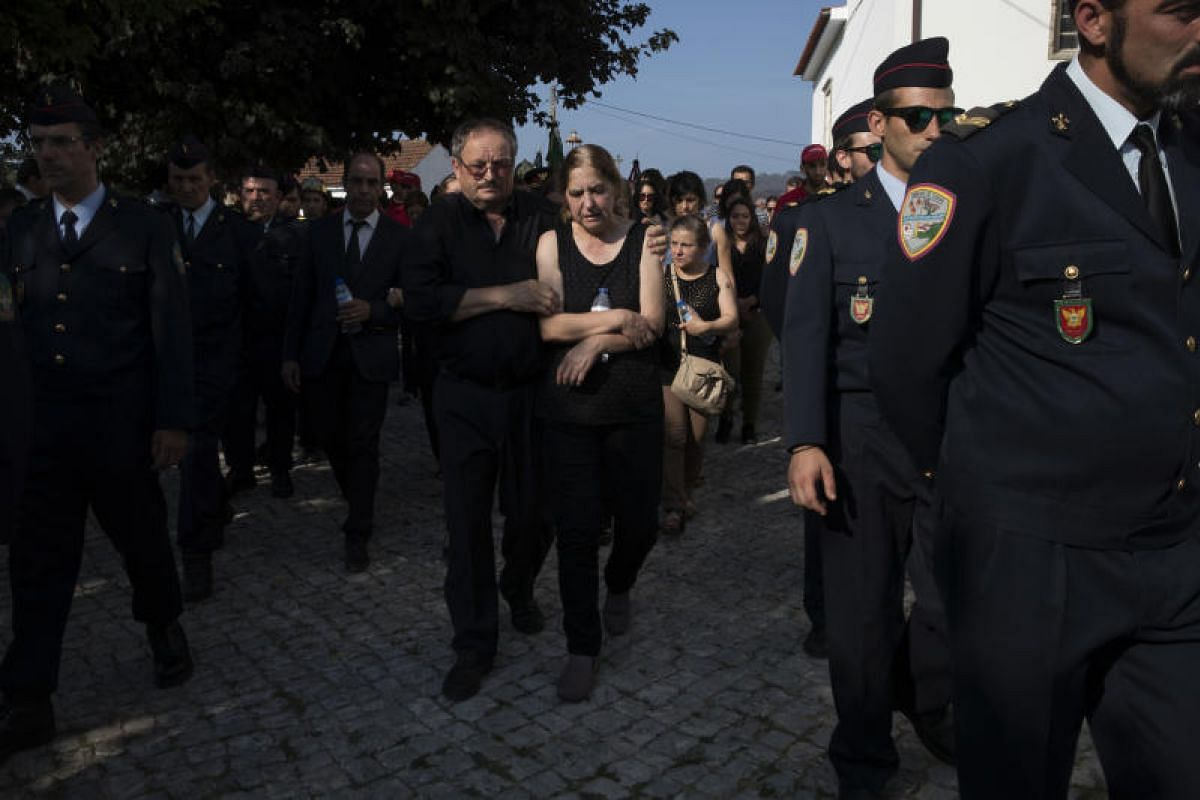 The funeral of firefighter Gonçalo Conceição, who died fighting the wildfires, in Castanheira de Pera, Portugal, on Wednesday (June 21) last week. Most of the firefighters who battled the blazes were volunteers.