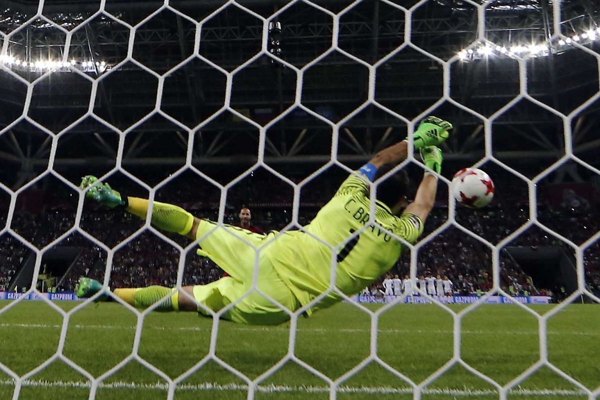 Goalkeeper Claudio Bravo of Chile saves a penalty of Ricardo Quaresma of Portugal during the penalty shootout during the FIFA Confederations Cup 2017 semi final match between Portugal and Chile at the Kazan Arena in Kazan, Russia, June 28, 2017. PHOT