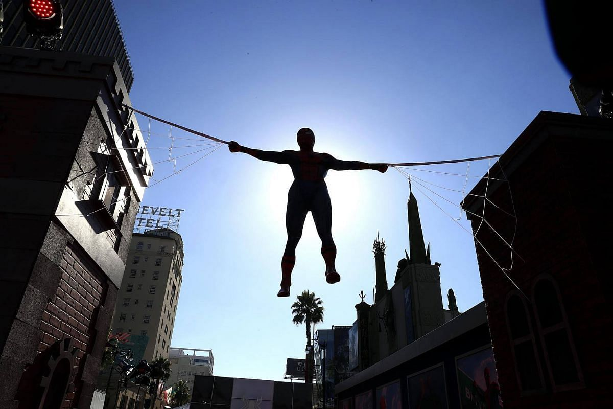 A life-size Spider-Man hangs above the Hollywood Boulevard outside TCL Chinese Theatre for the premiere of the upcoming Spider-Man movie in Hollywood, California on June 28, 2017.